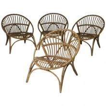 Quatre fauteuils en rotin et bambou. France 1950.