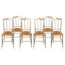 A set of six solid brass chairs by Chiavari Italy