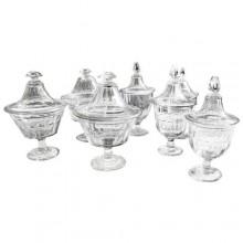 Sept bocaux à dragées sur piedouche en verre taillé. France fin du XIXème siècle