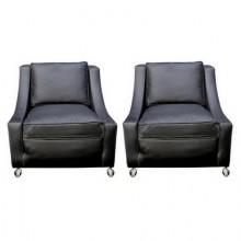 Paire de fauteuils recouverts de cuir époque 1940